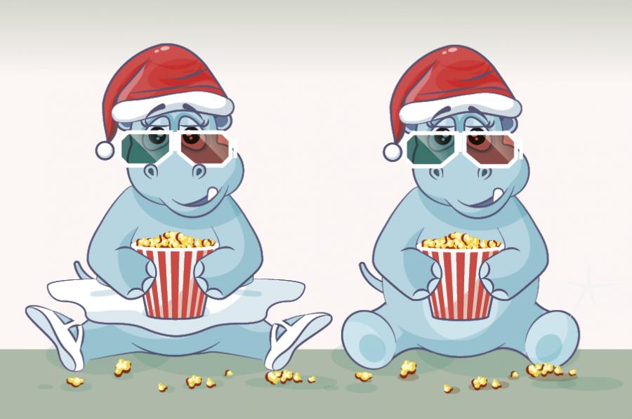 En snemand med rød halstørklæde, røde hansker og en nissehue kigger ned.